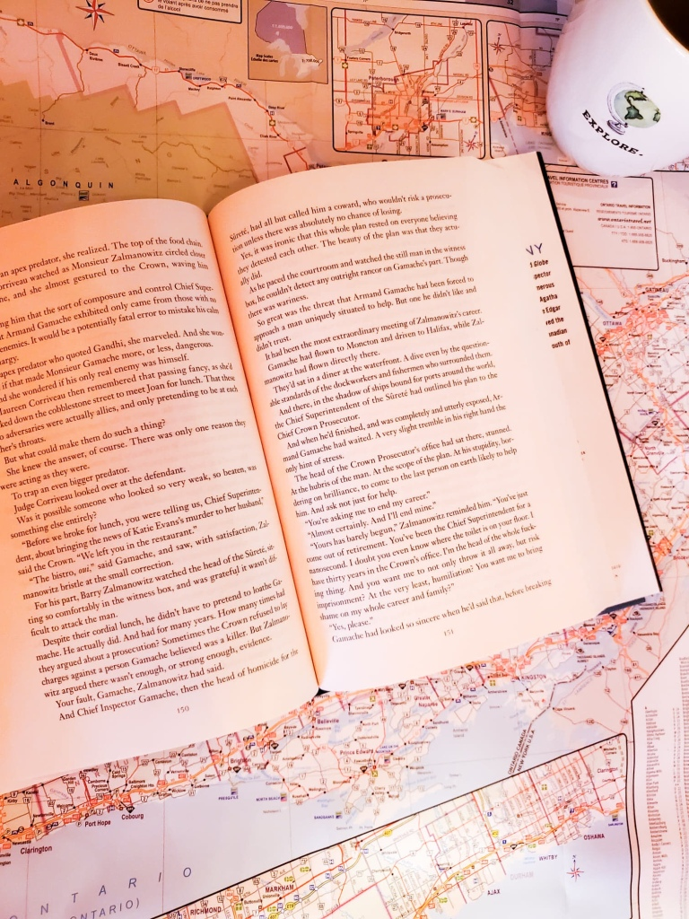 Image of a book lying open on an open map