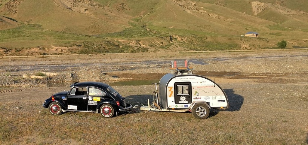 VW Bug pulling a small trailer